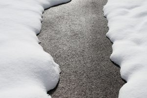 How Snow Affects Your Paved Driveways…What To Do